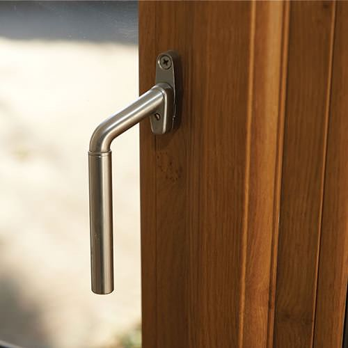 wood-grain finish and silver door handle add to the double glazing cost